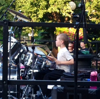8-year-old Christopher Ebel playing drums for DyVersaCo Photo by Renee Prola
