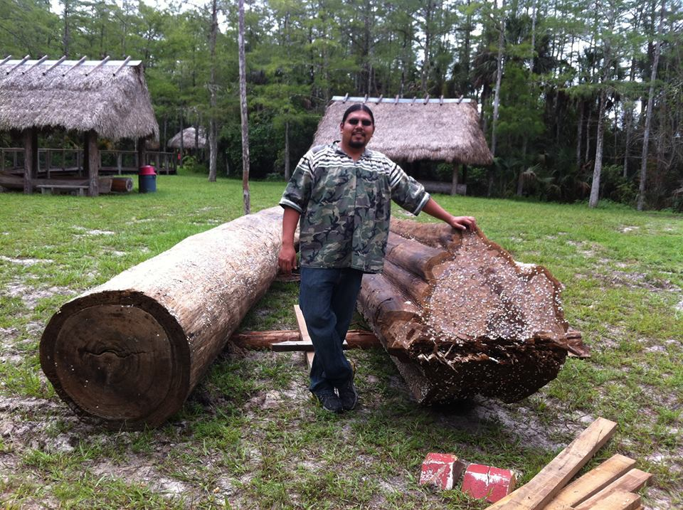 Pedro with two logs.