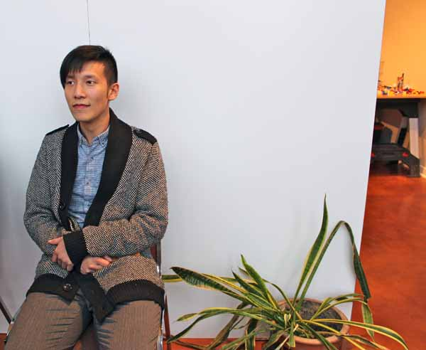 """Tai avails himself of a photo opportunity in the """"waiting room"""" of his """"office."""""""