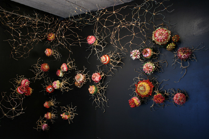 Alison Hiltner, Mimicry, 2009-2011. Mixed Media: Artificial Flowers, Wax, Clay, Wire, Hamster Runabouts and a variety of other things found and made. Photo courtesy of the artist's website.