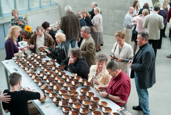 Guests selecting bowls at the Empty Bowl Project 2010. Photo courtesy of Zeber-Martell Studio