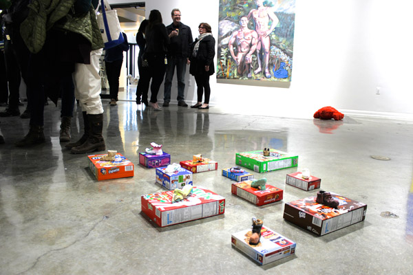 A collection of shoes with boxes by Mike Swaney, in the foreground.
